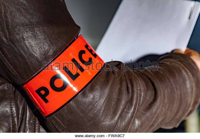 police-officer-wearing-a-police-sign-armband-fwa9c7 (1).jpg